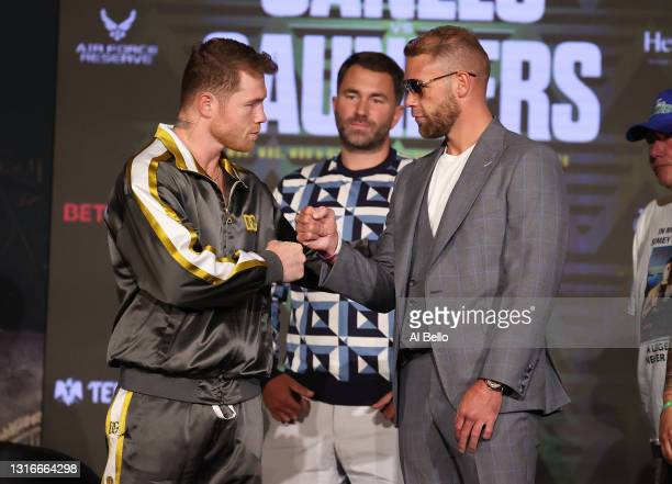 Canelo Alvarez and Billy Joe Saunders shake hands with Matchroom Promoter Eddie Hearn looking on during the press conference for Alvarez's WBC and...