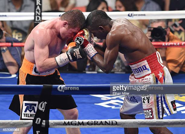 Canelo Alvarez and Erislandy Lara battle in the 12th round of their junior middleweight bout at the MGM Grand Garden Arena on July 12 2014 in Las...