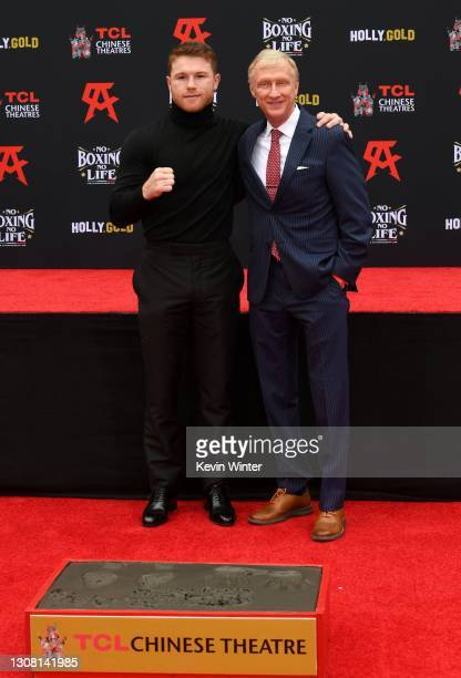 Canelo Alvarez and Jimmy Lennon Jr. Attend the Hand and Footprint Ceremony for boxer Canelo Alvarez at TCL Chinese Theatre on March 20, 2021 in...