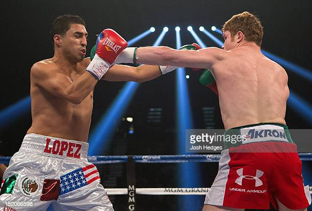 Canelo Alvarez and Josesito Lopez trade punches during their WBC super welterweight title fight at MGM Grand Garden Arena on September 15 2012 in Las...