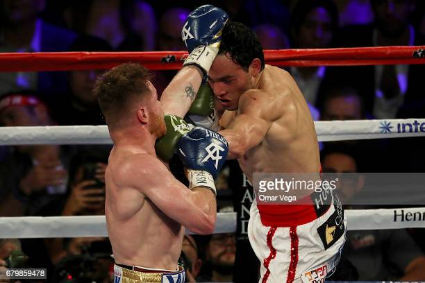 Canelo Alvarez and Julio Cesar Chavez Jr fight during their catchweight bout at TMobile Arena on May 6 2017 in Las Vegas Nevada