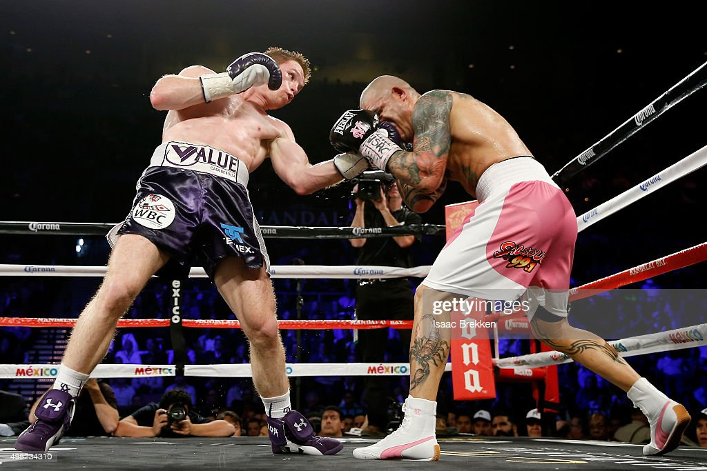 Canelo Alvarez and Miguel Cotto exchange blows during their middleweight fight at the Mandalay Bay Events Center on November 21, 2015 in Las Vegas, Nevada.