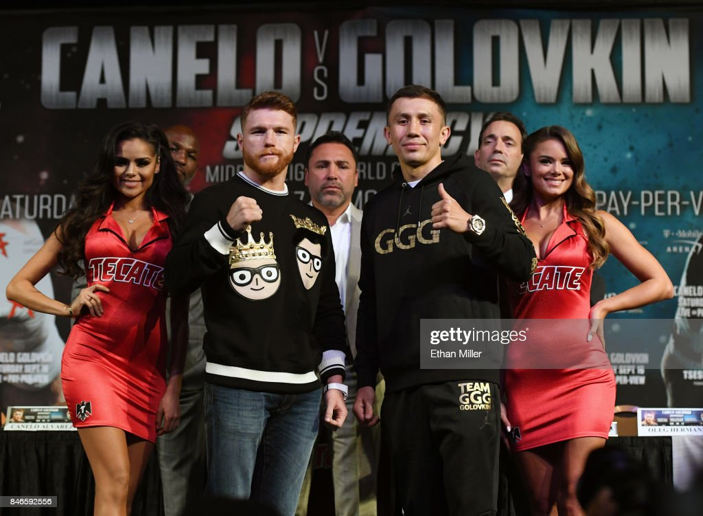 Canelo Alvarez (2nd L) and WBC, WBA and IBF middleweight champion Gennady Golovkin (2nd R) pose during a news conference at MGM Grand Hotel & Casino on September 12, 2017 in Las Vegas, Nevada. Golovkin will defend his titles against Alvarez at T-Mobile Arena on September 16 in Las Vegas.
