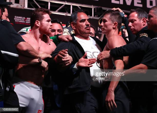 Canelo Alvarez and WBC/WBA middleweight champion Gennady Golovkin are held back after facing off during their official weighin at TMobile Arena on...