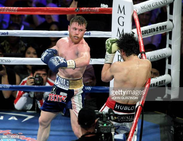 Canelo Alvarez attacks Julio Cesar Chavez Jr on the ropes May 6 2017 at the TMobile Arena in Las Vegas Nevada Saul 'Canelo' Alvarez cruised to a...