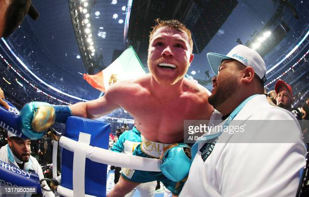 Canelo Alvarez celebrates after defeating Billy Joe Saunders who did not answer the bell for the eighth round during their fight for Alvarez's WBC...