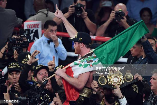 Canelo Alvarez celebrates after his majoritydecision win over Gennady Golovkin during their WBC/WBA middleweight title fight at TMobile Arena on...