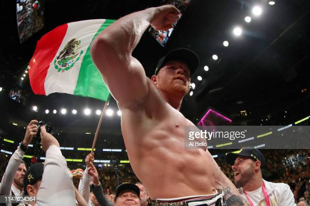 Canelo Alvarez celebrates after his unanimous decision win over Daniel Jacobs in their middleweight unification fight at T-Mobile Arena on May 04,...