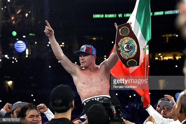 Canelo Alvarez celebrates after knocking out Liam Smith during the WBO Junior Middleweight World fight at ATT Stadium on September 17 2016 in...