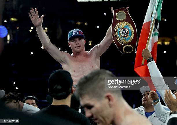 Canelo Alvarez celebrates after knocking out Liam Smith lower during the WBO Junior Middleweight World fight at ATT Stadium on September 17 2016 in...