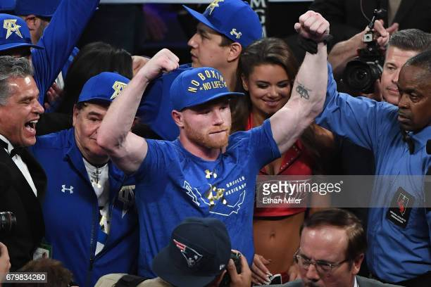 Canelo Alvarez celebrates his unanimousdecision victory over Julio Cesar Chavez Jr in their catchweight bout at TMobile Arena on May 6 2017 in Las...
