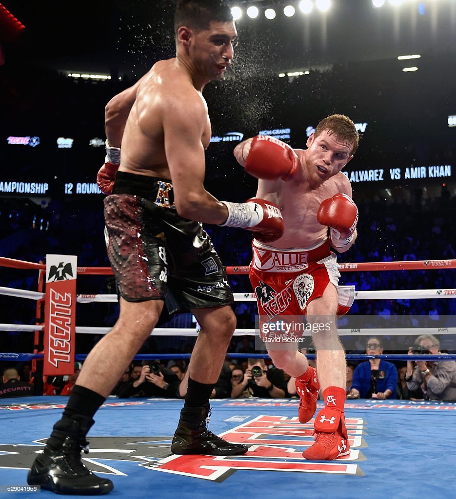 Canelo Alvarez (R) delivers the knockout punch to Amir Khan during the sixth round of their WBC middleweight title fight at T-Mobile Arena on May 7, 2016 in Las Vegas, Nevada.