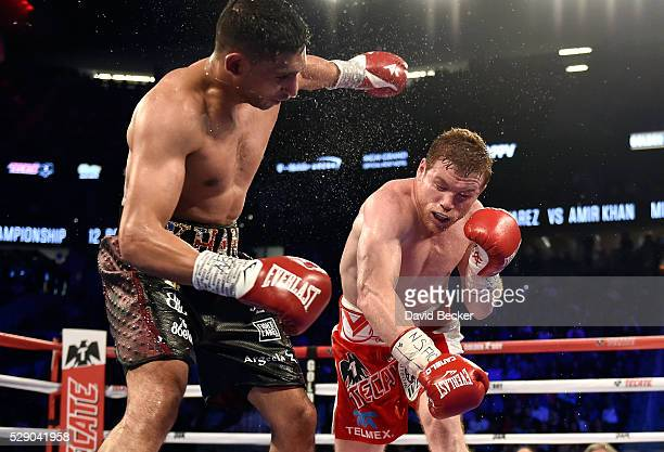 Canelo Alvarez delivers the knockout punch to Amir Khan during the sixth round of their WBC middleweight title fight at TMobile Arena on May 7 2016...
