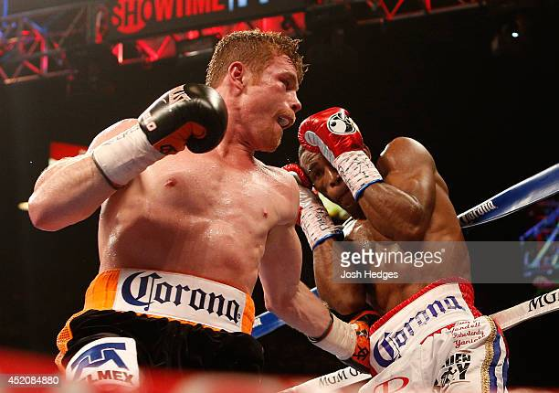 Canelo Alvarez digs a left to the body of Erislandy Lara during their junior middleweight bout at the MGM Grand Garden Arena on July 12 2014 in Las...