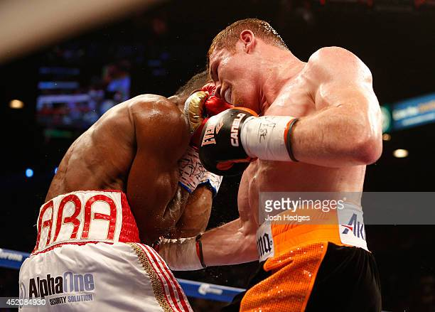 Canelo Alvarez digs a right to the body of Erislandy Lara during their junior middleweight bout at the MGM Grand Garden Arena on July 12 2014 in Las...