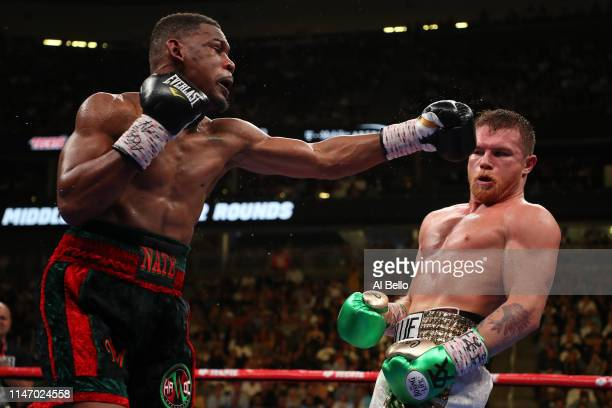 Canelo Alvarez dodges a punch by Daniel Jacobs during their middleweight unification fight at T-Mobile Arena on May 04, 2019 in Las Vegas, Nevada.