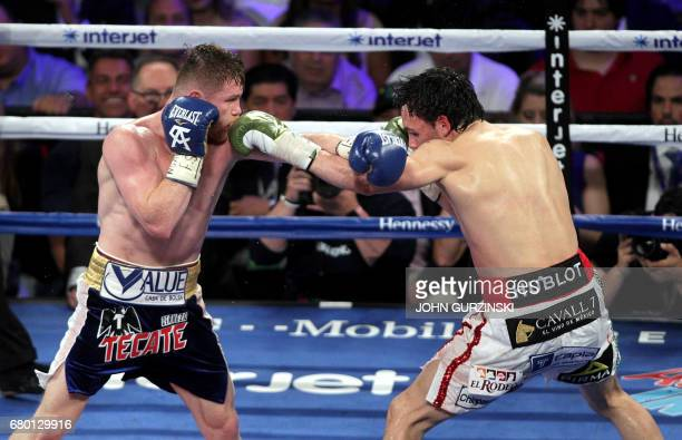 Canelo Alvarez excganges blows with Julio Cesar Chavez Jr on Saturday May 6 2017 at the TMobile Arena in Las Vegas Nevada Saul 'Canelo' Alvarez...