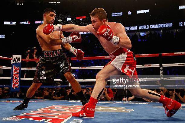Canelo Alvarez fights with Amir Khan during the WBC middleweight title fight at TMobile Arena on May 7 2016 in Las Vegas Nevada