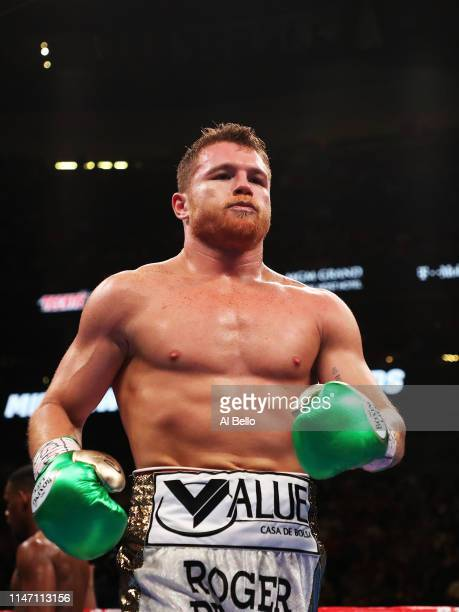Canelo Alvarez heads back to his corner during his unanimous decision win over Daniel Jacobs in their middleweight unification fight at T-Mobile...