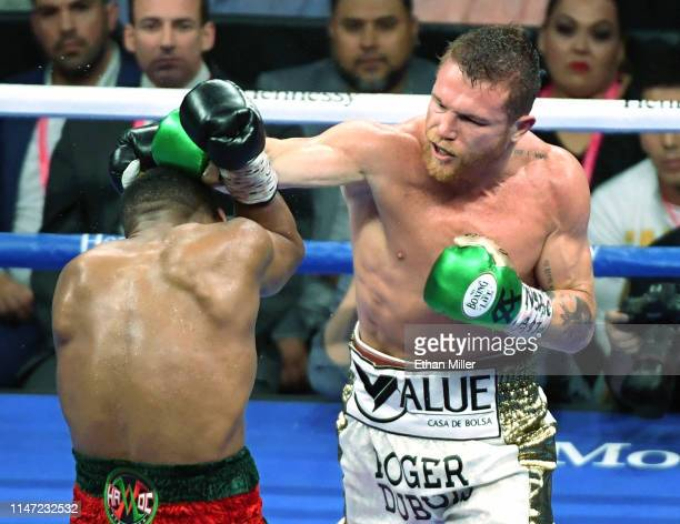 Canelo Alvarez hits Daniel Jacobs in the fifth round of their middleweight unification fight at T-Mobile Arena on May 4, 2019 in Las Vegas, Nevada....