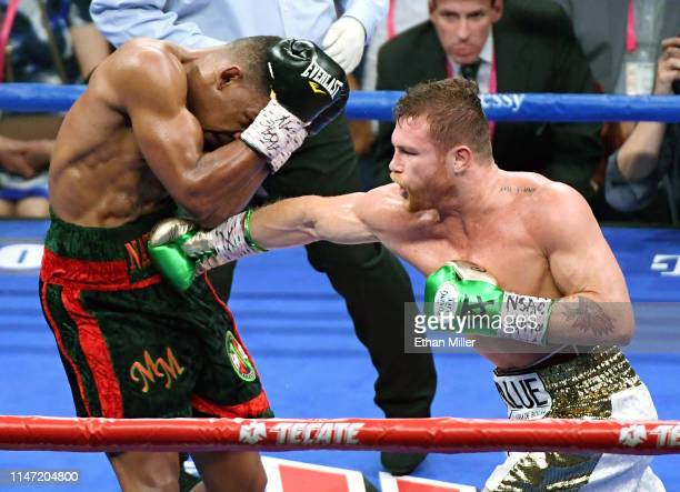 Canelo Alvarez hits Daniel Jacobs in the fourth round of their middleweight unification fight at T-Mobile Arena on May 4, 2019 in Las Vegas, Nevada....