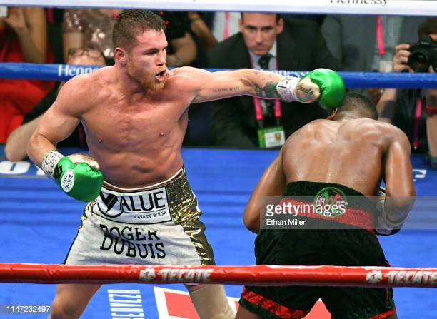 Canelo Alvarez hits Daniel Jacobs in the ninth round of their middleweight unification fight at T-Mobile Arena on May 4, 2019 in Las Vegas, Nevada....