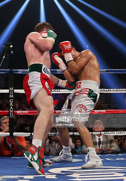 Canelo Alvarez knocks lands a left to the body of Josesito Lopez during their WBC super welterweight title fight at MGM Grand Garden Arena on...