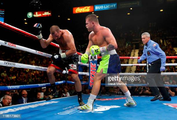 Canelo Alvarez knocks out Sergey Kovalev in the 11th round of their WBO light heavyweight fight as referee Russell Mora looks on at MGM Grand Garden...