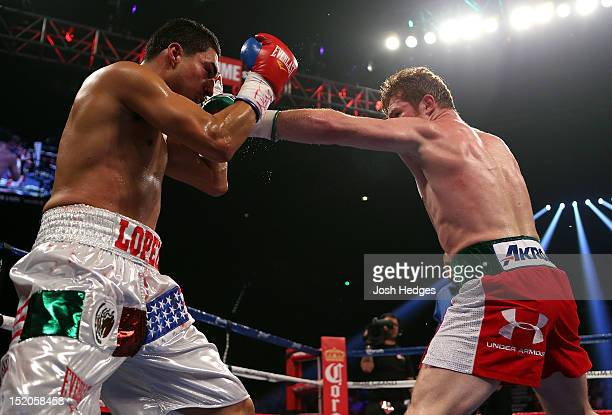 Canelo Alvarez lands a left to the head of Josesito Lopez during their WBC super welterweight title fight at MGM Grand Garden Arena on September 15...