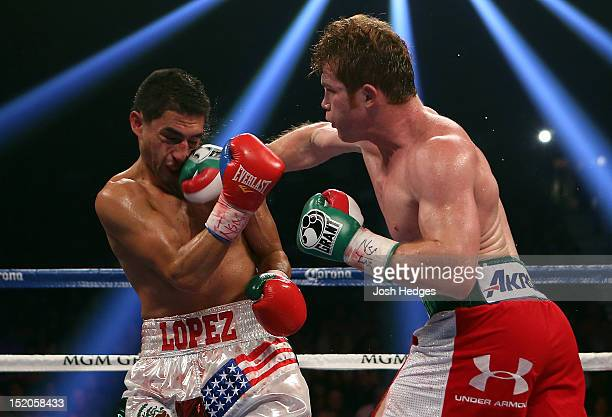 Canelo Alvarez lands a right to the head of Josesito Lopez during their WBC super welterweight title fight at MGM Grand Garden Arena on September 15...