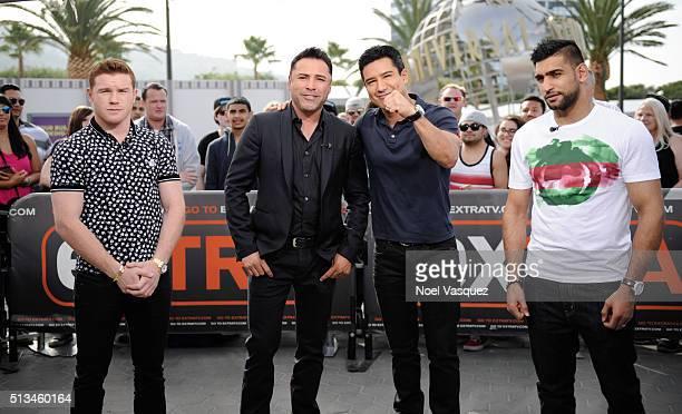 Canelo Alvarez Oscar De La Hoya Mario Lopez and Amir Khan visit 'Extra' at Universal Studios Hollywood on March 2 2016 in Universal City California