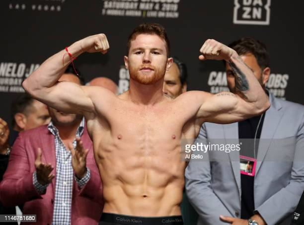 Canelo Alvarez poses on the scale during his official weigh in against Daniel Jacobs at T-Mobile Arena on May 3, 2019 in Las Vegas, Nevada. Alvarez...