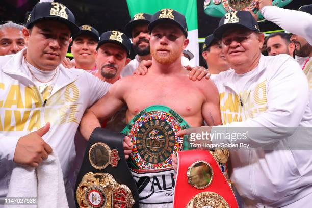 Canelo Alvarez poses with his championship belts after his unanimous decision win over Daniel Jacobs in their middleweight unification fight at...