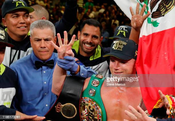 Canelo Alvarez poses with referee Russell Mora following his victory over Sergey Kovalev in WBO light heavyweight title fight at MGM Grand Garden...