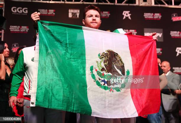 Canelo Alvarez poses with the Mexican flag during his official weighin at TMobile Arena on September 13 2018 in Las Vegas Nevada Alvarez will...