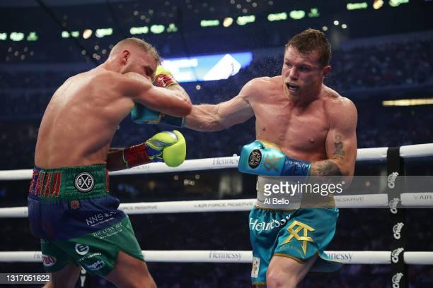 Canelo Alvarez punches Billy Joe Saunders during their fight for Alvarez's WBC and WBA super middleweight titles and Saunders' WBO super middleweight...
