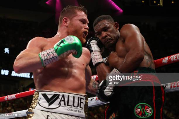 Canelo Alvarez punches Daniel Jacobs during their middleweight unification fight at TMobile Arena on May 04 2019 in Las Vegas Nevada