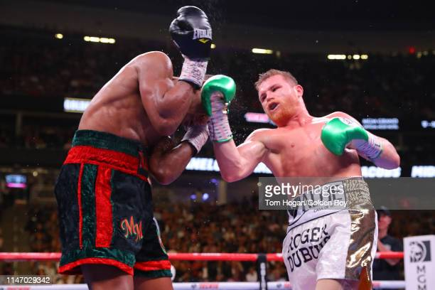 Canelo Alvarez punches Daniel Jacobs during their middleweight unification fight at T-Mobile Arena on May 04, 2019 in Las Vegas, Nevada.