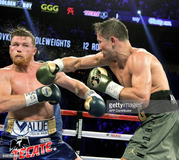 Canelo Alvarez reacts against a right hook from Gennady Golovkin during their WBC WBA and IBF middleweight championship fight at the TMobile Arena on...