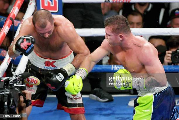 Canelo Alvarez sends Sergey Kovalev into the ropes in the 11th round of their WBO light heavyweight title fight at MGM Grand Garden Arena on November...