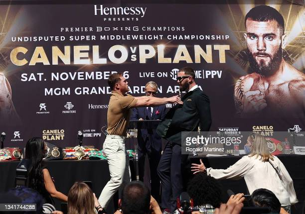 Canelo Alvarez shoves Caleb Plant during a face-off before a press conference ahead of their super middleweight fight on November 6 at The Beverly...