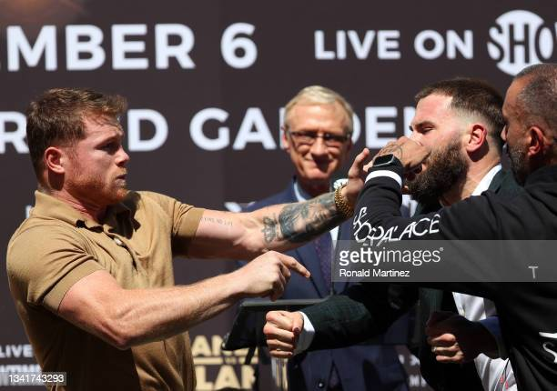 Canelo Alvarez slaps Caleb Plant during a face-off before a press conference ahead of their super middleweight fight on November 6 at The Beverly...