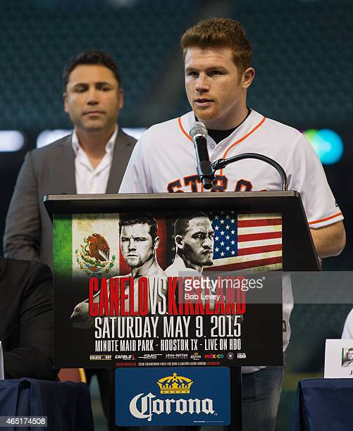 Canelo Alvarez speaks during a press conference to promote his May 9th fight against James Kirkland as Oscar De La Hoya looks on at Minute Maid Park...