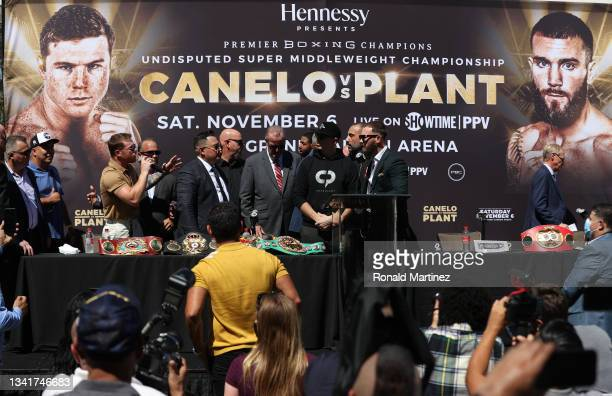 Canelo Alvarez speaks to Caleb Plant during a press conference ahead of their super middleweight fight on November 6 at The Beverly Hilton on...