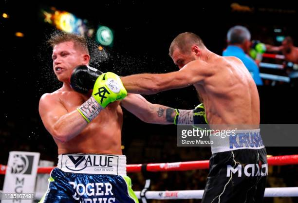 Canelo Alvarez takes a punch from Sergey Kovalev during their WBO light heavyweight title fight at MGM Grand Garden Arena on November 2, 2019 in Las...