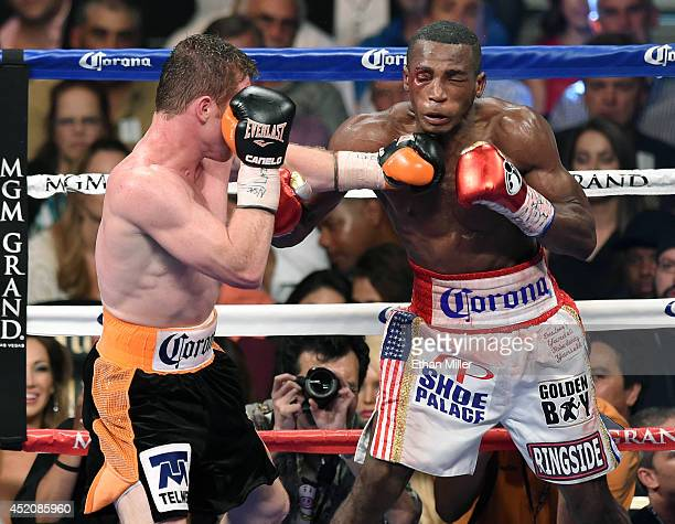 Canelo Alvarez throws a left at Erislandy Lara battle in the 12th round of their junior middleweight bout at the MGM Grand Garden Arena on July 12...