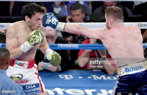 Canelo Alvarez throws a left at Julio Cesar Chavez Jr in the third round of their 1645pound catchweight bout on May 6 2017 in Las Vegas Nevada...