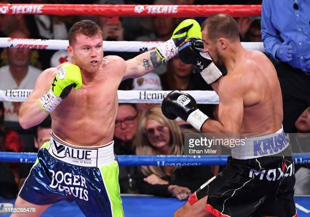 Canelo Alvarez throws a left at Sergey Kovalev in the second round of their WBO light heavyweight title fight at MGM Grand Garden Arena on November...