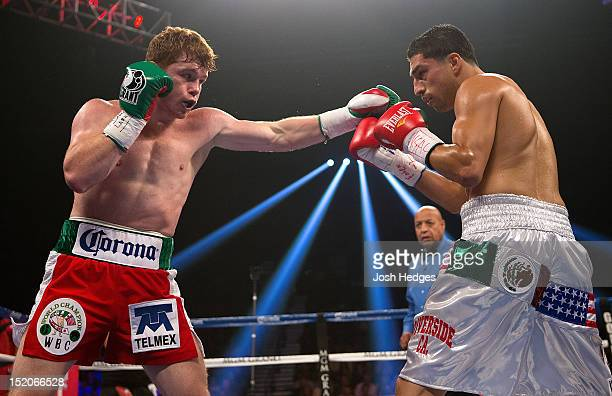 Canelo Alvarez throws a left at the head of Josesito Lopez during their WBC super welterweight title fight at MGM Grand Garden Arena on September 15...