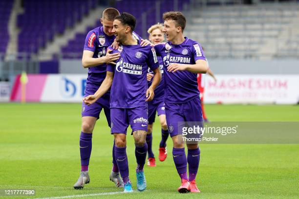 Caner Cavlan of Young Violets celebrates scoring a goal with team-mates Aleksandar Jukic and Csaba Mester during the 2. Liga match between Young...